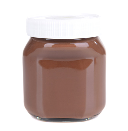 Sweet chocolate cream in jar isolated on white