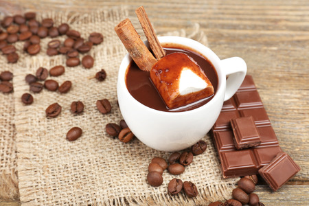 Cup of hot chocolate on table, close up photo