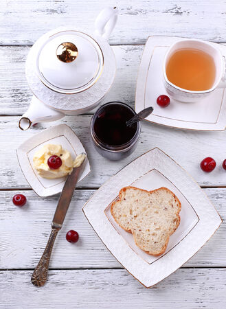 Fresh toast with  homemade butter on plate on wooden background photo