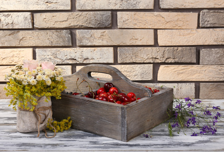 Fresh berries in wooden box, close up photo