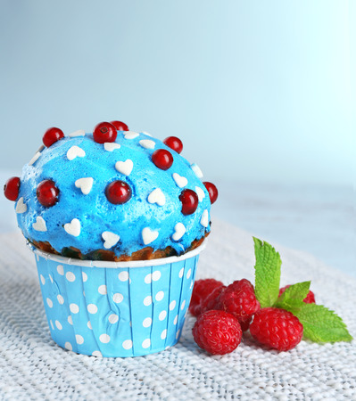 Tasty cupcake on table, close up photo