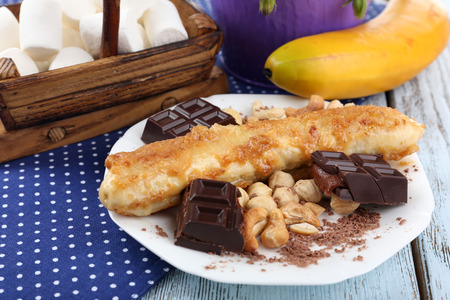 sweetened: Sweetened fried banana on plate, close-up