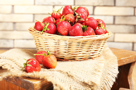 plant sweet: Fresh strawberries in basket on wall