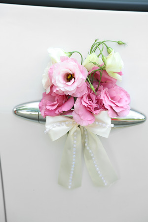 Wedding car decorated with flowers photo