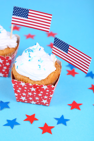 American patriotic holiday cupcakes on blue background photo