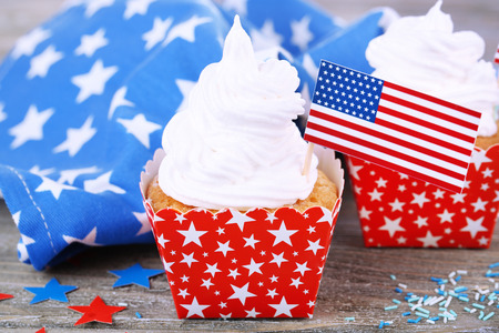 American patriotic holiday cupcakes on wooden table photo