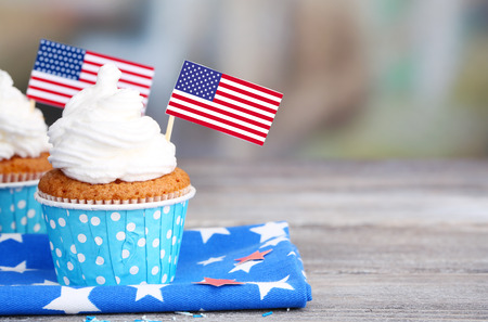 American patriotic holiday cupcakes on wooden table Stock Photo