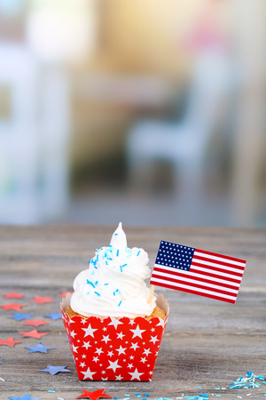 American patriotic holiday cupcake on wooden table photo