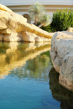 escapement: Beautiful landscaping. Lake with stone bridge