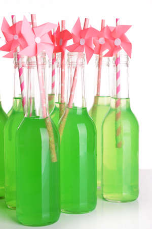 a straw: Bottles of drink with straw on light background Stock Photo