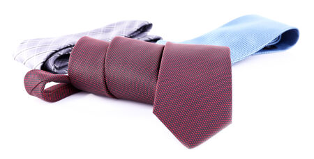 Brown, blue and grey ties on white background isolated photo