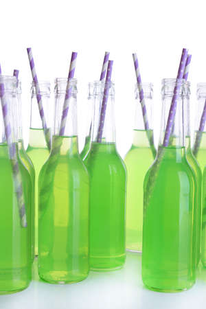 Bottles of drink with straw isolated on white photo