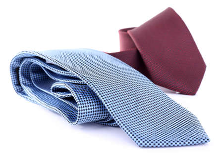 Brown and blue ties on white background isolated photo