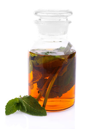tincture: Bottle of herbal tincture on white background isolated