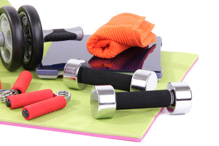 espander: Sport requisites on a carpet isolated on white