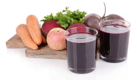beet juice: Glasses of fresh beet juice and vegetables on cutting board isolated on white