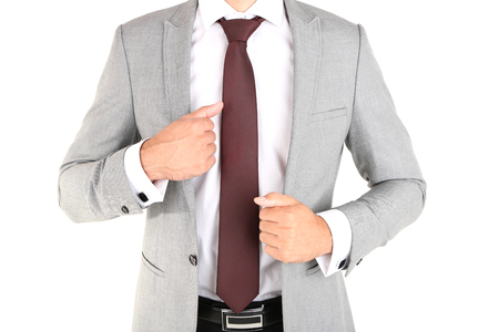 Man doing tie up isolated on white photo