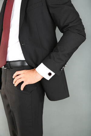 Man in black suit on grey background photo