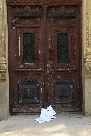 enveloped: Letters on floor at front door Stock Photo