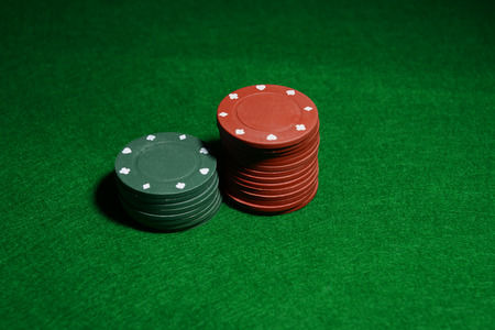 Chips for poker on green table Stock Photo