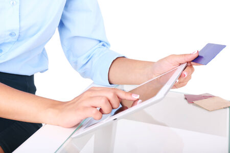 Woman using digital tablet and holding credit card in her hand. On-line shopping concept photo