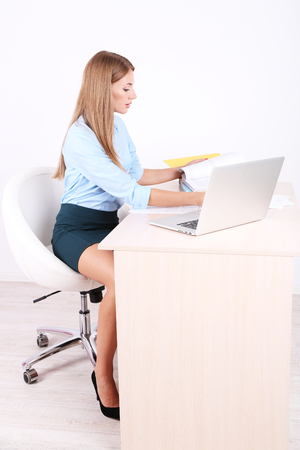 Business woman with documents at her workplace