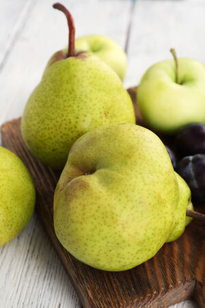 Ripe fruits on table close up photo