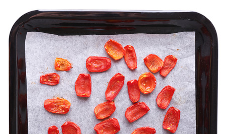 sun dried: Sun dried tomatoes on drying tray, isolated on white