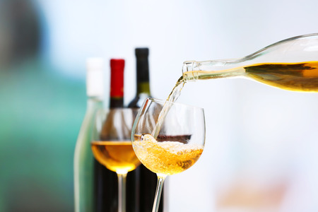 tasting wine: Wine pouring into wine glass, close-up