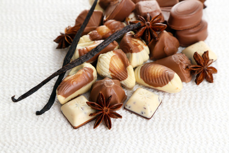 kinds: Different kinds of chocolates with spices on white background Stock Photo