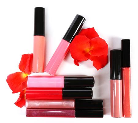 beautify: Beautiful lip glosses, isolated on white Stock Photo