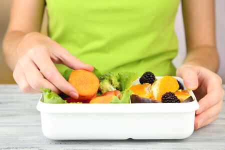 Woman making tasty vegetarian lunch, close up photo