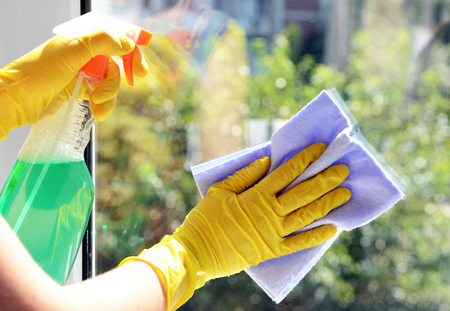 Cleaning windows with special rag and cleaner Stok Fotoğraf