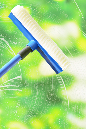 Cleaning windows with special squeegee