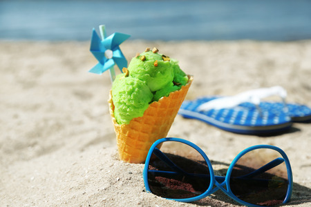 Ice cream in sand on beach photo