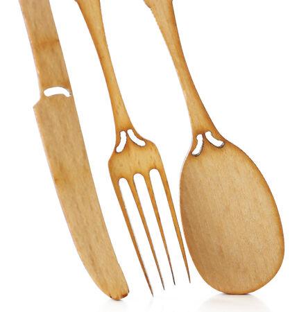 Decorative wooden utensils isolated on white photo