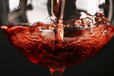 Glass of red wine on dark background closeup Stockfoto