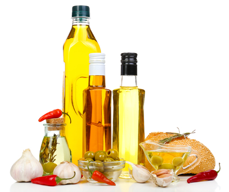Different sorts of cooking oil, isolated on white photo