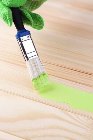 modernise: Brush painting wooden furniture, close up