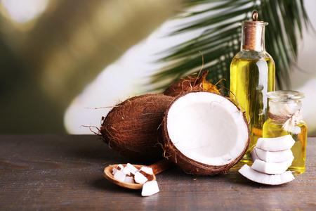 Coconuts and coconut oil on wooden table Foto de archivo