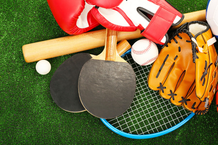 Sports equipment on grass background Banco de Imagens