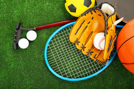 youth sports: Sports equipment on grass background Stock Photo