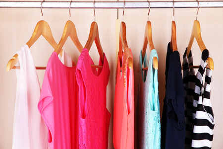 woman closet: Female clothes on hangers in wardrobe