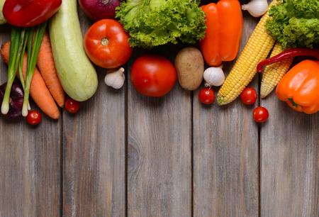 Fresh organic vegetables on wooden background Stock Photo