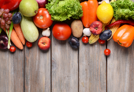 fresh produce: Fresh organic fruits and vegetables on wooden background