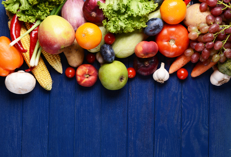 of fruit: Fresh organic fruits and vegetables on wooden background