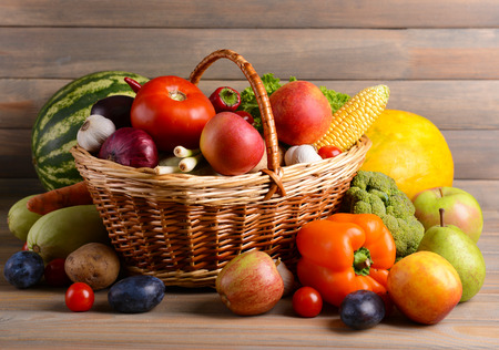 fruit red: Fresh organic fruits and vegetables on wooden background