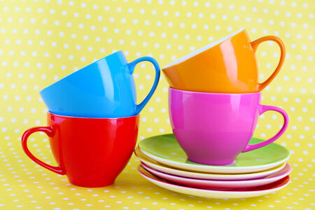 saucers: Colorful cups and saucers on color