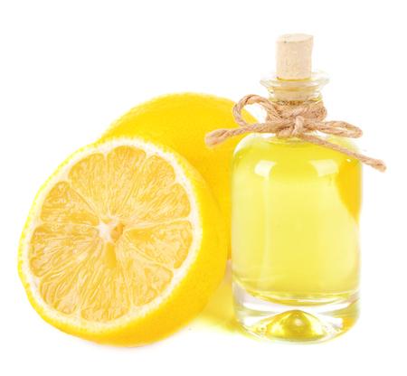 lemon: El aceite de lim�n aislado en blanco Foto de archivo