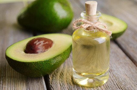 Avocado olie op tafel close-up Stockfoto